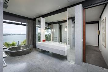 A volcanic stone bathtub is the centrepiece here. Image: 19