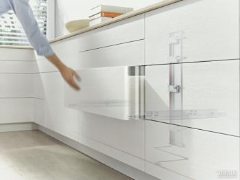 Hands full? Blum drawer opens at touch of a knee