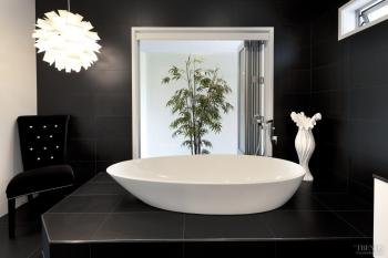 On a pedestal – elevated bathtub takes centre stage. Image: 13