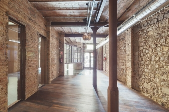 New glass complements old brick in this commercial rethink by Nook.