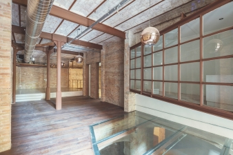 The opening of the original staircase has been sealed with weight-bearing glass, converting it into a skylight that illuminates the basement.