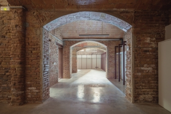 This interior architectural redesign showcases the vault structures of the original building