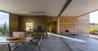 The living space, the only space open to both the north and south facades, is the heart of the house and also acts as a barrier to the music studio on its west from the bedrooms to the east.