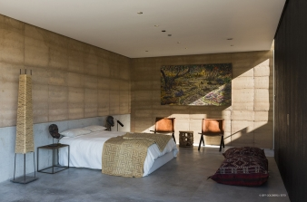 Charred Spanish cedar clads the walls of the bedroom zone