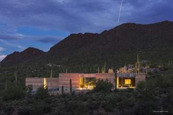 Dusk shot of rammed earth desert home by DUST