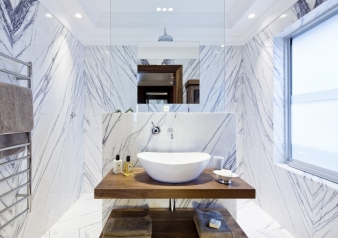 Book matched marble bathroom  in renovated harbourside home by designer Claire Rendall