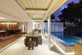 Outdoor living area and pool  in renovated harbourside home by designer Claire Rendall