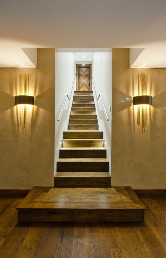 Entry hall and staircase in renovated harbourside home by designer Claire Rendall