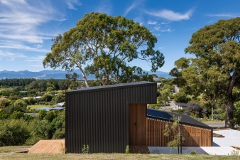 The roofing material wraps down both the north and south elevations of this home