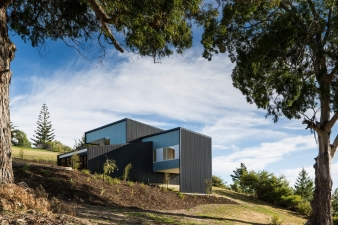 This is a small-medium 3-bedroom house sitting along a southward sloping hill