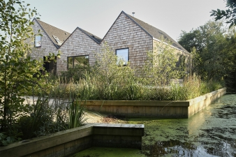 To the front and rear elevations the timber shingles are left untreated to allow them to weather and create a warm textured appearance
