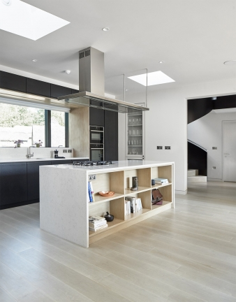 The central bay contains a large kitchen and dining area, and flows into the adjacent double height living space