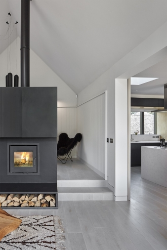 A steel clad fireplace in the family home of architect Patrick Michell