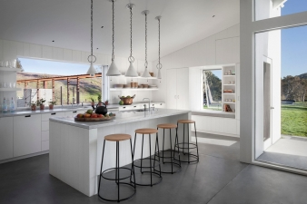 The kitchen has slide away windows that open directly to the garden.
