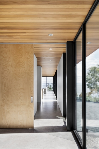 Glass facade running alongside the master suite in a new home by Bourgeois / Lechasseur architects