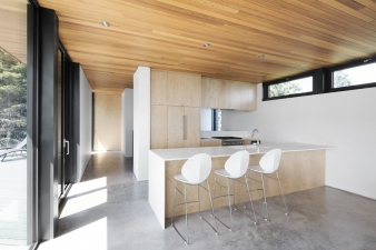 The kitchen is on the second floor and opens to a deck and terrace