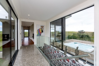 A large deck complete with built-in spa is a feature of this spacious house by Fowler Homes Taranaki