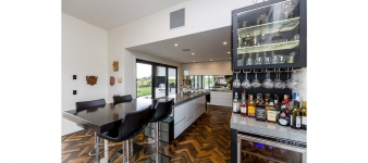Wining and dining – everything is to hand in the living areas of this new Fowler Homes Taranaki residence.
