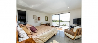 Most bedrooms in this Fowler Homes Taranaki design have direct access to the views.