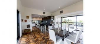 A beautiful herringbone wood floor features in this Fowler Homes Taranaki award-winning home.