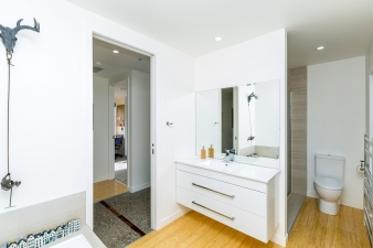 Contemporary, intelligently laid out bathrooms are a feature of this Fowler Homes residence.