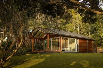 They are sited facing northwest, concealed and immersed within the native bush of the terrain