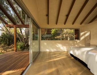 Sliding glass doors retain a sense of connection to the landscape