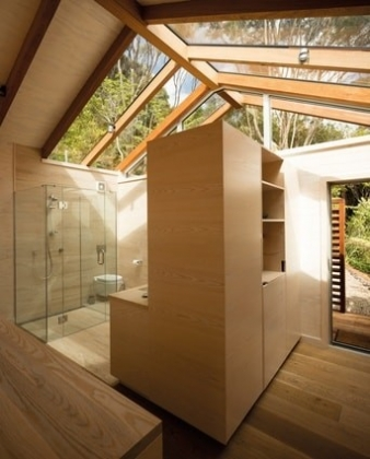 A slatted screen wall provides privacy to an outdoor shower at the rear, while retaining a sense of connection to the landscape