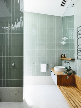 Bathroom with vertical subway tiles in a new home by Architects EAT