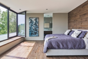 The master suite in this new home occuppies the top level, providing a retreat and degree of separation from the day to day activity inthe house