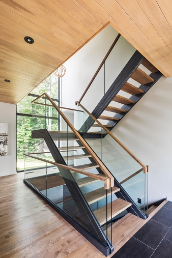 A lack of columns makes these stairs appear to float in the Estrade residence by Mu Architecture