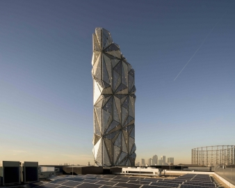 The cladding of the 49 metre high stack tower unites sophisticated engineering and complex optic research to create an impressive sculptural concept on a huge scale