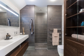 At the end of the ensuite is a fully tiled, his'n'hers walk-in shower, complete with robe hooks and heated towels rails