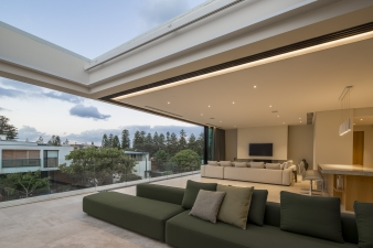 """The upper level terrace has an operable """"sunroof"""" that can close to be watertight or open to the sky"""