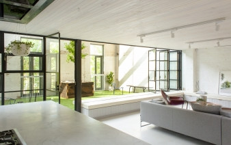 The main living room and kitchen connect directly to the backyard