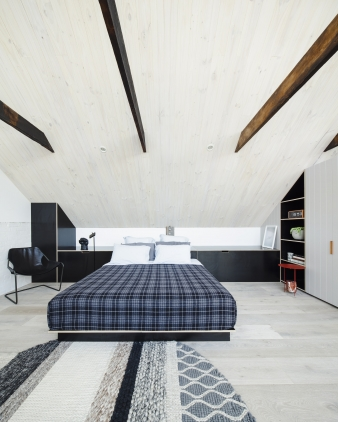 Master bedroom  in a warehouse conversion by Architects EAT