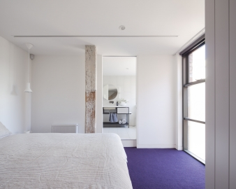 Secondary bedroom  in a warehouse conversion by Architects EAT