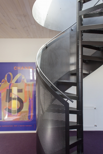 Steel spiral staircase in an old warehouse converted to a family home