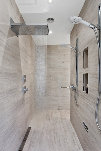 The owner didn't want a glass shower – designer Mark Bruce came up with this tiled, walk-through double shower as the solution