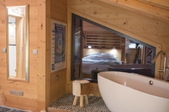The original low-ceilinged structure now houses private spaces and bedrooms