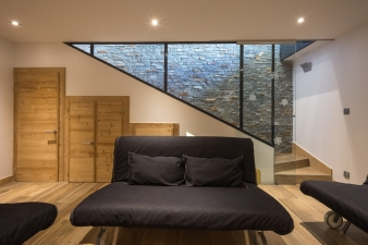 The modern interiors of the addition contain socialising spaces