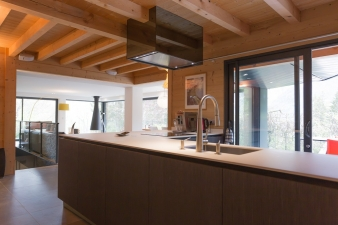 Kitchen in  addition to a mountain home by  Chevallier Architectes