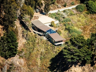 The house is cantilevered 12 feet back from the bluff, both to protect the cliff's delicate ecosystem and to ensure the structure's integrity and safety
