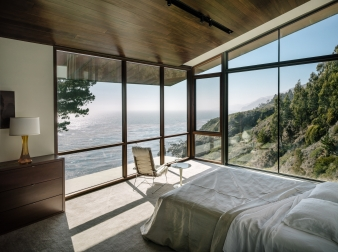 A double-cantilevered master bedroom suite acts as a promontory above the ocean, offering breath-taking views from its floor-to-ceiling windows