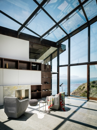 The glass library/den connects the two wings of the home by Fougeron Architecture