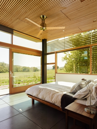 Extensive cross ventilation and ceiling fans, combined with shading slats at tall windows susceptible to direct sun exposure keep this home cool on hot day