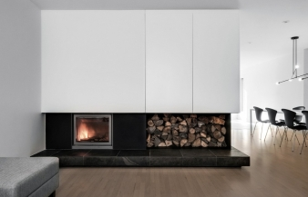Fireplace in Montreal renovated home by Appareil Architecture