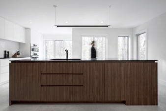 Kitchen island in Montreal renovated home by Appareil Architecture