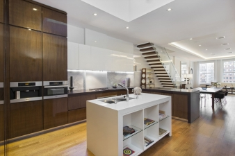 The kitchens at 738 Broadway are equipped with Miele and Sub-Zero appliances concealed within quality custom designed Italian cabinets