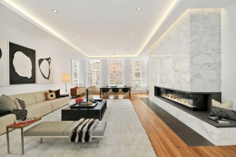 The Italian Calacatta marbleA 17-foot long fireplace creates a centre of attention in this New York apartment by Escobar Design by Lemay